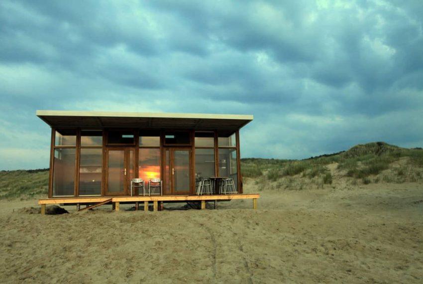 Zonsondergang strandhuisje Cadzand